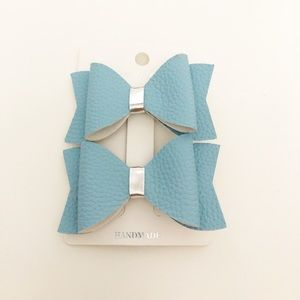 Sale 2/$10. Light Blue Leather Bow Hair Clips